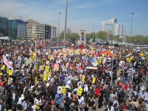 "[Protesters flood Taksim Square for the ""Internetime Doukunma"" (""Don't Touch My Internet"") protest in 2011. Gezi Park can be seen in the background. Photo by Jay Cassano."