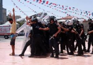 [A protestor and police in Gezi Park. 31 May 2013. From Yücel Tunca via Nar Photos.]