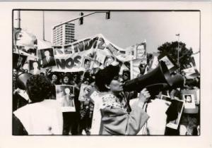 Women protest killings in Algiers on March 22, 1994, carrying the picture of Tahar Djaout, among others. Photo: El Watan