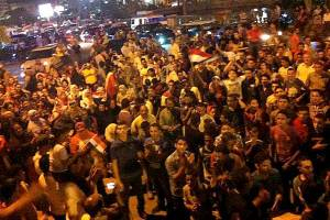 Protesters in the city of Fayoum, Egypt, celebrate the fall of Morsi
