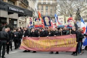 Members of the extreme right-wing organisation 'La Troisieme Voie' protest against US imperialism on February 2 2013 in Paris.