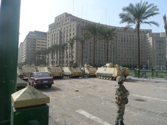 The Mugamma looms above Tahrir Square, guarded by soldiers, during the Egyptian revolution, January 2011: by Joseph Hill