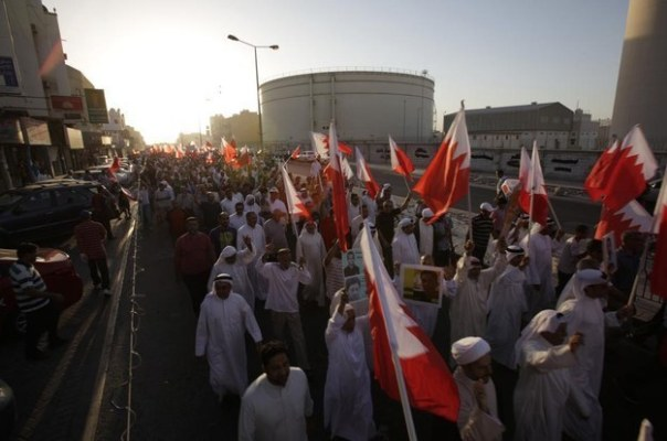 A few thousand anti-government Bahrainis waved national flags and carried pictures of political prisoners during a protest march in Sitra, Bahrain, Friday, Sept. 12. AP Photo/Hasan Jamali